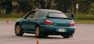 subaru drifting in parking lot film factory